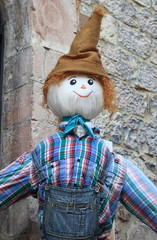 A funny and smiling scarecrow