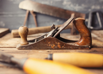 Od vintage hand tools on wooden background. Focus on Jack-plane.