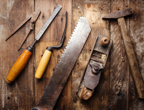 Od vintage hand tools on wooden background. Carpenter workplace - 77012697