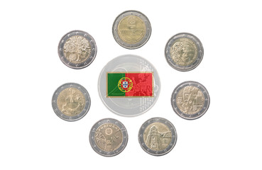 Collection of commemorative coins of Portugal isolated on white