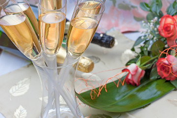Champagne and bouquet of roses for special occasion