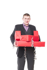 man in a suit with gift boxes