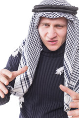 man's face covered with Arab scarf