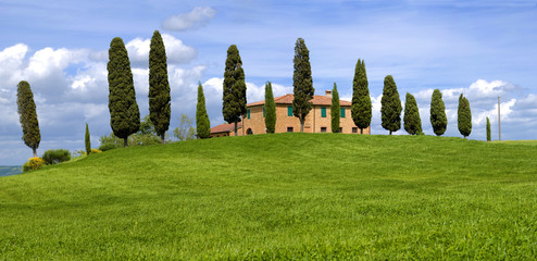 House on the hill with cypress trees, Tuscany