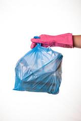 Hand holding trash bag