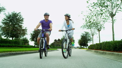 Young Heterosexual Ethnic Couple Cycling Fitness