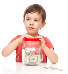 Cute boy with dollars