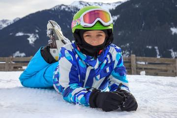 Girl lying on the snow