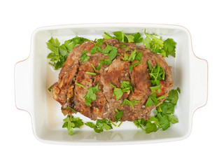 A large piece of veal pork cooked in the oven with a ceramic bak