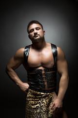 Muscular dancer dressed as prehistoric man