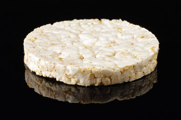 Rice cracker isolated on the black background with reflection