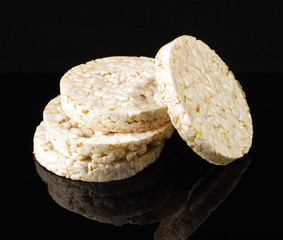 Stack of rice crackers isolated on the black background