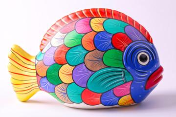 multicolored ceramic fish on white background