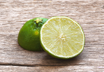 Lime,Lemon cut on wooden table