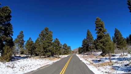 POV driving barren landscape blue dry climate vehicle Zion National Park Utah USA