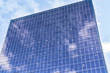 Sky and clouds reflection on building facade