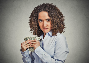 greedy woman corporate employee holding dollar banknotes