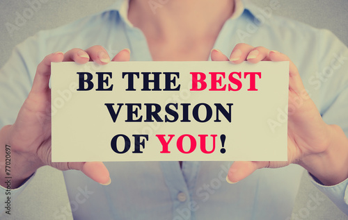 Businesswoman hands card sign be the best version of you