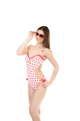 Smiling young woman in swimsuit wearing sun glasses, isolated