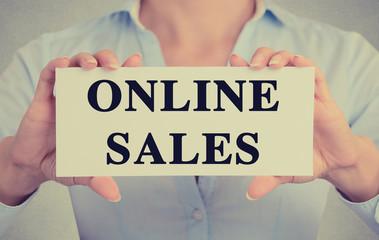 Businesswoman hands holding card sign online sales message