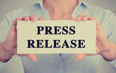 Businesswoman hands holding sign press release message