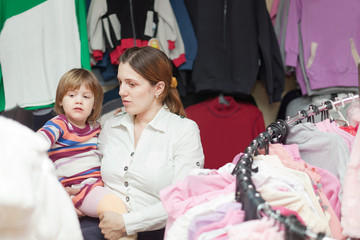 mother and  baby girl  at clothes shop