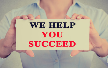 Businesswoman hands sign we help you succeed message