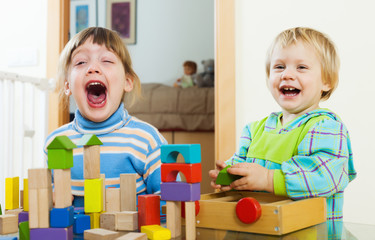 Emotional siblings  with toy blocks in home