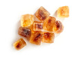 Brown caramelized sugar cubes on a white background