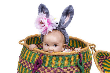 cute baby in basket with bunny ears