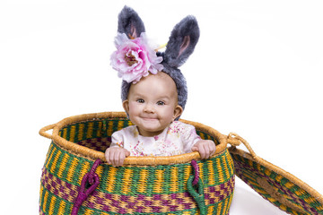 smiling baby with bunny ears