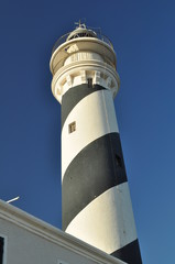 close up of a lighthouse in a village around mediterranean coast