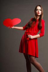 Girl holding red heart love sign