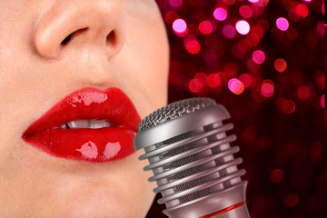 Woman with red lips and retro microphone