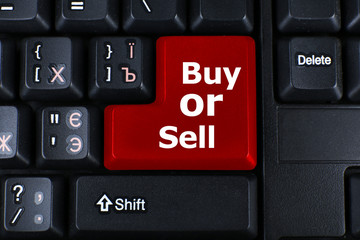 Close up of Buy or Sell keyboard button