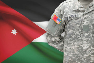 American soldier with flag on background - Jordan