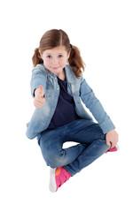 Adorable little girl with saying Ok