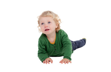Adorable blond baby lying on the floor
