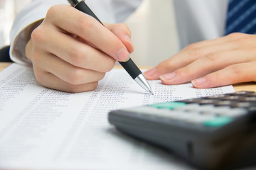 Businessman calculating the financial statements