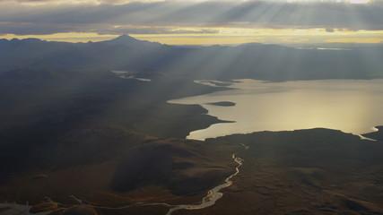 Aerial sunlight rays meltwater lake river deltas Katla active volcano Iceland