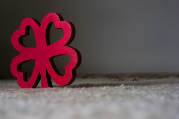 Red wooden four leaf clover