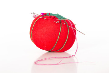 Red tomato shaped pin cushion