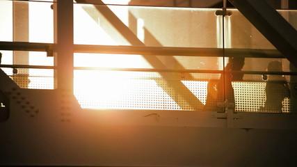 Tokyo travellers elevated modern glass walkway sun flare travel Japan