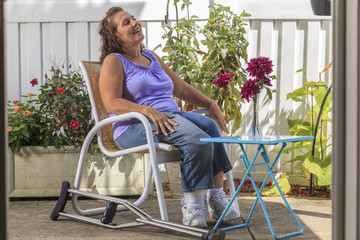 Woman with Spina Bifida relaxing in garden