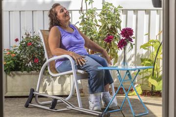 Woman with Spina Bifida relaxing in garden