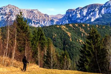 Man contemplating the beautiful Bucegi mountains in Romania