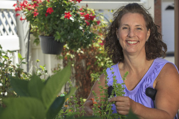 Woman with Spina Bifida using crutches tending to garden