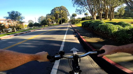 POV road cycling healthy physical active outdoor exercise rural USA