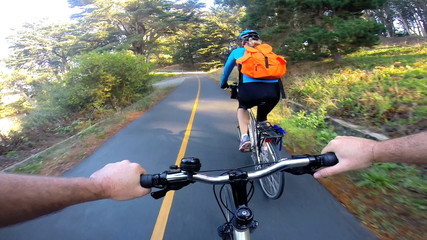POV bike riding adventurous couple exercising together  USA