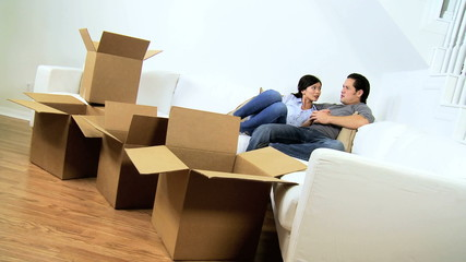 Ethnic Couple Relaxing White Couch New Home